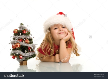 stock-photo-little-girl-with-small-christmas-tree-on-the-table-dreaming-about-the-holidays-isolated-copy-63309307